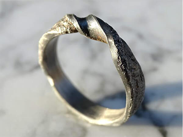 infinity viking wedding band made of molten sterling silver2 1