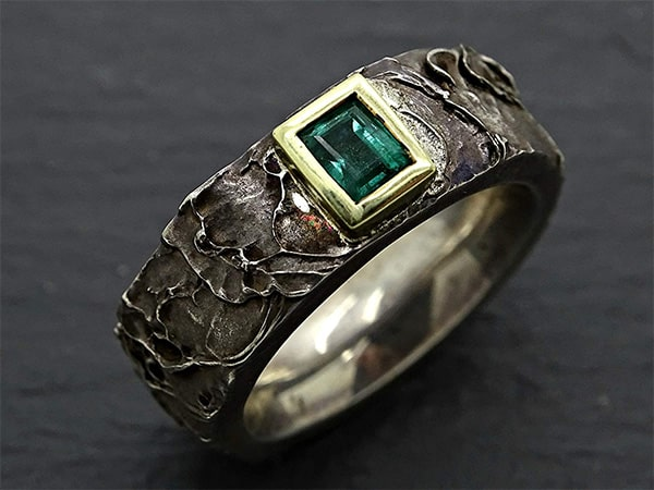 mens viking emerald celtic wedding ring with gold and silver 1 min