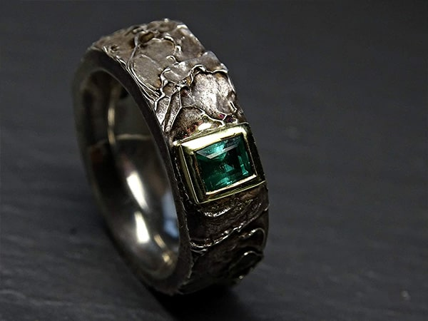 mens viking emerald celtic wedding ring with gold and silver 3 min