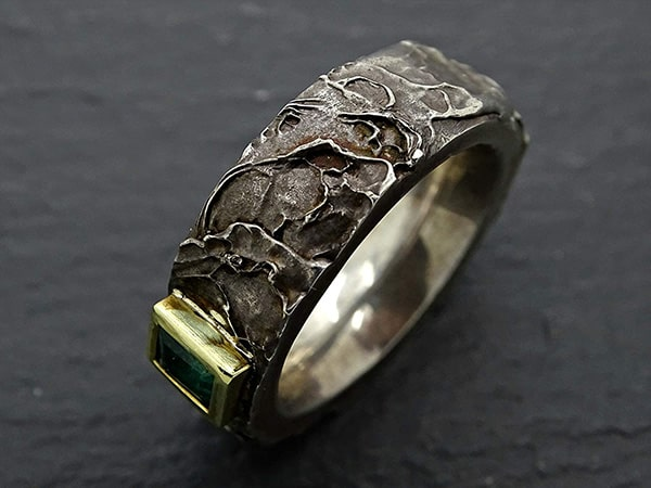 mens viking emerald celtic wedding ring with gold and silver 4 min